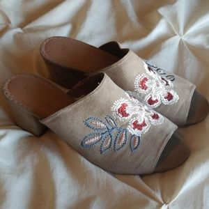 Restricted embroidered mules
